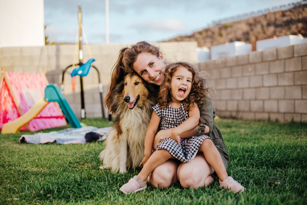 single parent with daughter and border collie